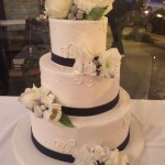 Defloured Ribbon and Flowers Three Tier Wedding Cake