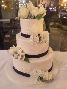 Defloured Ribbon and Flowers Three Tier Wedding Cake